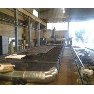 General view of flame-cutting machine with a capacity of cutting metal plates of 12 meters long - CMA Group